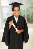 Black college graduate. Attractive young black college graduate holding certificate indoors Royalty Free Stock Images