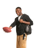 Black College Student Holding Football Stock Photo
