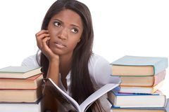 Black college student woman by stack of books Royalty Free Stock Photography