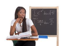 Black college student woman studying math exam. Stressed High school or college ethnic African-American female student sitting by the desk at math class Royalty Free Stock Photography