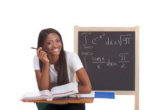 Black college student woman studying math exam. Happy Friendly High school or college ethnic African-American female student sitting by the desk at math class Royalty Free Stock Photos