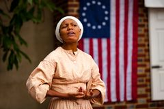Black Colonist at Betsy Ross House. Philadelphia, PA, USA - August 13, 2011: A costumed interpreter portrays an early Afro-American woman at the Betsy Ross House Stock Photos