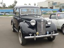 Black color 1946 Austin 12 made in the UK in Lima. Lima, Peru. July 23, 2017. Front and side view of a splendid black color Austin 12 made in the UK in 1946 royalty free stock image