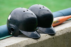 Black color Baseball helmets Stock Images