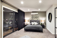 Black color bed in luxurious hotel with flashing lamps Stock Photography