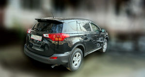 Black color car on a blurred background. Stock Image