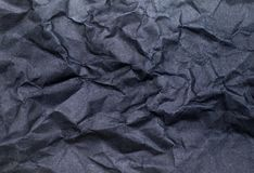 Black color crumpled paper texture background Stock Photography