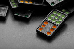 Black color dominoes with colorful dot Royalty Free Stock Photography