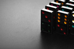 Black color dominoes with colorful dot game pieces Stock Images