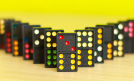 Black color dominoes with colorful dot on table Stock Images