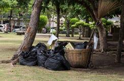 Black color garbage bag on lawn Stock Images