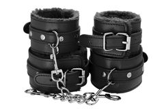 Black color leather handcuffs isolate on white background royalty free stock photo