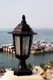 Black color metal postlamp. Vintage black color metal postlamp Royalty Free Stock Photography