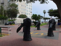 Black color statues in Barranco district of Lima Royalty Free Stock Photos