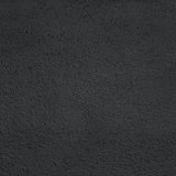 Black color  stone texture with grain. Distress textured Grainy Royalty Free Stock Photo
