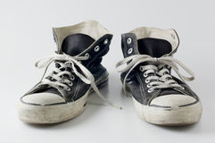 Black color vintage sneakers. Close-up photography Stock Photos