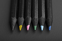 Black, colored pencils, on black background stock image