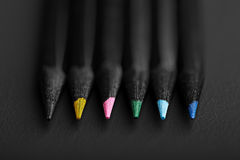 Black, colored pencils, on black background, Shallow depth of field. Black, colored pencils, Shallow depth of field royalty free stock photos