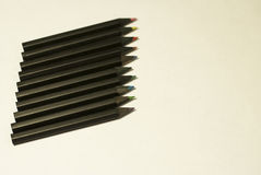 Black colored pencils on white background Royalty Free Stock Image
