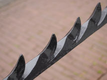 Black colored wrought iron fence bar with spikes Royalty Free Stock Photography
