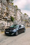 Black colour Peugeot 308 car on background of French mountain nature Royalty Free Stock Photos