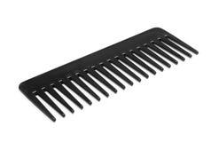 Black comb isolated on white background. Black comb isolated on a white background Royalty Free Stock Photo