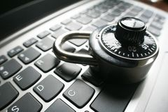 Black Combination Lock On Laptop Keyboard Representing Cyber Security. High Quality Royalty Free Stock Image