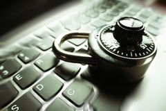 Black Combination Lock Zoom Burst On Laptop Keyboard Representing Cyber Security. High Quality Stock Images