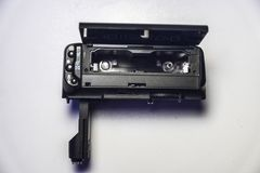 Black Compact Camera on White Surface Stock Image