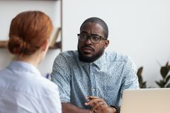 Boss listening candidate female consider her unsuitable for job royalty free stock image