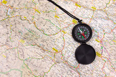 Black compass. On a map Royalty Free Stock Photos