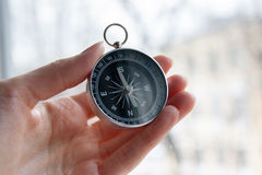 Black compass in  female hand Stock Images