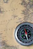 The Black compass on old vintage map, north atlantic ocean, macro background Royalty Free Stock Photo
