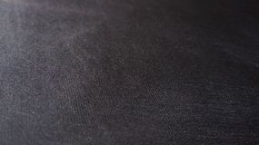 Black Compound Cloth Fabric Flat Texture Detail Closeup Angle. Angle view of a black compound cloth fabric texture Royalty Free Stock Images