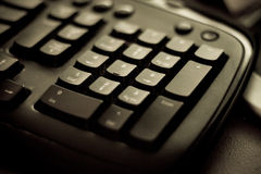 Black computer keyboard. Black desktop computer keyboard close-up details royalty free stock photo