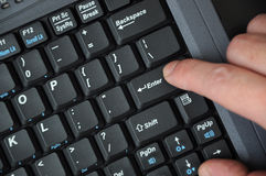 Black computer keyboard with hands Royalty Free Stock Photography
