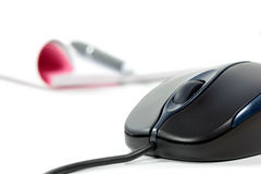 Black Computer Mouse And Writing Pad Royalty Free Stock Image