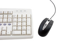 Black computer mouse and part of keyboard. Royalty Free Stock Photo