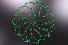 Black concentric spiral flower shape with green glowing elements Stock Photos