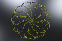 Black concentric spiral flower shape with yellow glowing element Royalty Free Stock Images