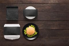 Black concept burger set on wooden background. Copy space for te Stock Photo