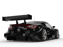 Black concept sports car - large tail wing and big taillights Stock Photography