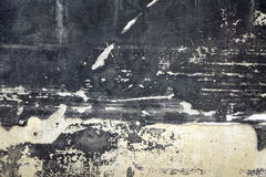 Black Concrete Wall With White Spots And Wreck Plaster Layer royalty free stock photos