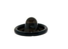 Black condom. Black round condom on a white background Royalty Free Stock Photography
