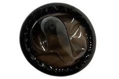 Black condom. From the latex, photographed from above Royalty Free Stock Image