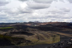 Black cone-shaped crater of the extinct volcano Nverfjall in Iceland Royalty Free Stock Images