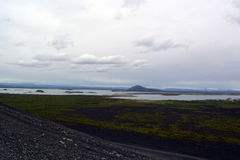 Black cone-shaped crater of the extinct volcano Nverfjall in Iceland Stock Photos