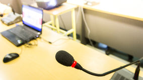 Black conference microphone and computer used for meetings and t Stock Photo