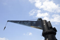 Black construction crane from below Stock Images
