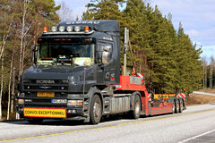 Black Conventional Scania 164L Semi Trailer on Road Royalty Free Stock Photography